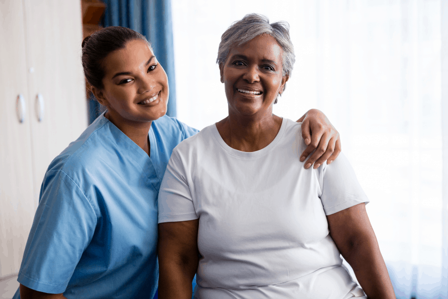 happy nurse and patient during hospice care
