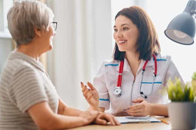 nurse goes over main management options with hospice client