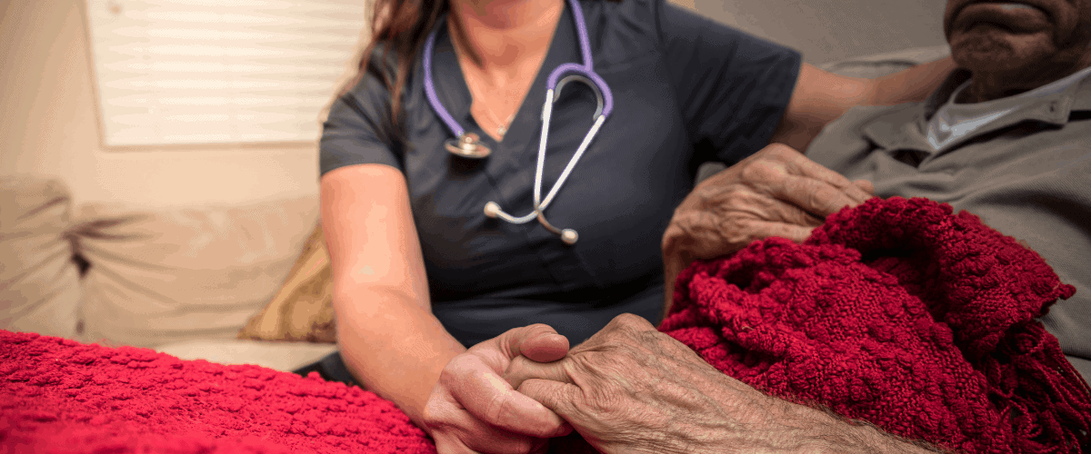 woman comforted in hospice care