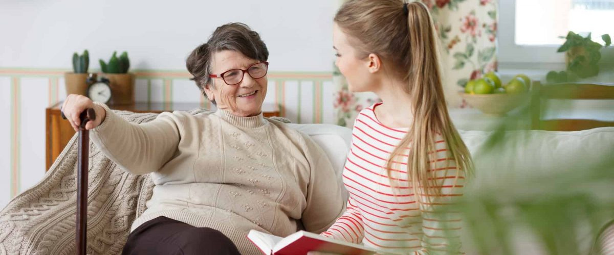 Grandma talking to her granddaughter
